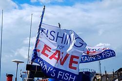 Fishing for LEAVE flags on fishing boats in Whitstable, Kent England<br /> <br /> (c) Andrew Wilson | Edinburgh Elite media