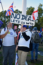 Remainer talking to a Leaver at a small counter protest at the People's Vote march, London 19 October 2019 UK