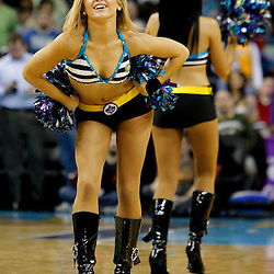 January 19, 2011; New Orleans, LA, USA; New Orleans Hornets Honeybees dancers perform during an overtime quarter in a game against the Memphis Grizzlies at the New Orleans Arena. The Hornets defeated the Grizzlies 130-102 in overtime.  Mandatory Credit: Derick E. Hingle