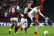 Dele Alli of Tottenham Hotspur (R) goes past Mark Noble of West Ham United ©. EFL Carabao Cup, 4th round match, Tottenham Hotspur v West Ham United at Wembley Stadium in London on Wednesday 25th October 2017.<br /> pic by Steffan Bowen, Andrew Orchard sports photography.