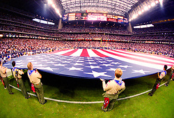 Stock photo of Boy Scouts holding a massive flag at Reliant Stadium