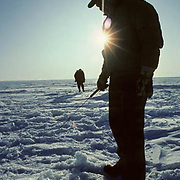 Ice fishing on lake in northern Minnesota for perch and crappies. Winter.