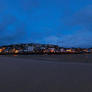200118 x 3821 pixel, 289 MB file....A very large file which will print very big, 4 meters plus long.<br /> <br /> St Ives (Cornish: Porth Ia, meaning St Ia's cove) is a seaside town, civil parish and port in Cornwall, England, United Kingdom. The town lies north of Penzance and west of Camborne on the coast of the Celtic Sea. In former times it was commercially dependent on fishing. The decline in fishing, however, caused a shift in commercial emphasis, and the town is now primarily a popular holiday resort, notably achieving the title of Best UK Seaside Town from the British Travel Awards in both 2010 and 2011. St Ives was incorporated by Royal Charter in 1639. St Ives has become renowned for its number of artists. It was named best seaside town of 2007 by the Guardian newspaper. It should not be confused with St Ive, a village and civil parish in south-east Cornwall.