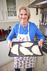 © Licensed to London News Pictures.  03/05/2014. DIDCOT, UK. Former Great British Bake off contestant Christine Wallace pictured at her home in Didcot making the new Oxford Pasty she has created. It contains local sourced lamb and mint and uses a combination of rough and puff pastry. Photo credit: Cliff Hide/LNP
