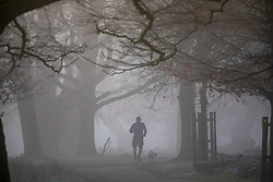© Licensed to London News Pictures. 06/02/2020. London, UK. A runner enjoys the dense fog in Richmond Park this morning as weather experts predict high winds and heavy rain for the weekend. Photo credit: Alex Lentati/LNP