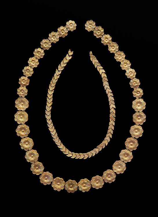 Mycenaean gold necklace from the Mycenaean cemetery of Midea tholos tomb , Dendra, Greece. National Archaeological Museum Athens. Black Background<br /> <br /> Inside mycenaean necklace has gold ivy leaf beads, Cat No 7354. The outer mycenaean necklace has rosette shaped gold beads, Cat No 7342. 15th-14th century BC. .<br /> <br /> If you prefer to buy from our ALAMY PHOTO LIBRARY  Collection visit : https://www.alamy.com/portfolio/paul-williams-funkystock/mycenaean-art-artefacts.html . Type -   Athens    - into the LOWER SEARCH WITHIN GALLERY box. Refine search by adding background colour, place, museum etc<br /> <br /> Visit our MYCENAEN ART PHOTO COLLECTIONS for more photos to download  as wall art prints https://funkystock.photoshelter.com/gallery-collection/Pictures-Images-of-Ancient-Mycenaean-Art-Artefacts-Archaeology-Sites/C0000xRC5WLQcbhQ