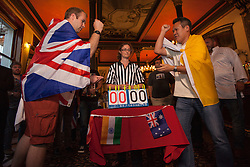© licensed to London News Pictures. London, UK 08/08/2012. Great Britain and Vatican City teams competing against each other at the UK Rock Paper Scissors Championship at The Knights Templar Pub in central London. Over 100 contestants take part in unique decision making competition. Photo credit: Tolga Akmen/LNP