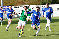 Kevin Nisbet (15) of Hibernian and Cove Rangers Blair Yule (8) battle for the ball during the Betfred Scottish League Cup match between Cove Rangers and Hibernian at Balmoral Stadium, Aberdeen, Scotland on 10 October 2020.