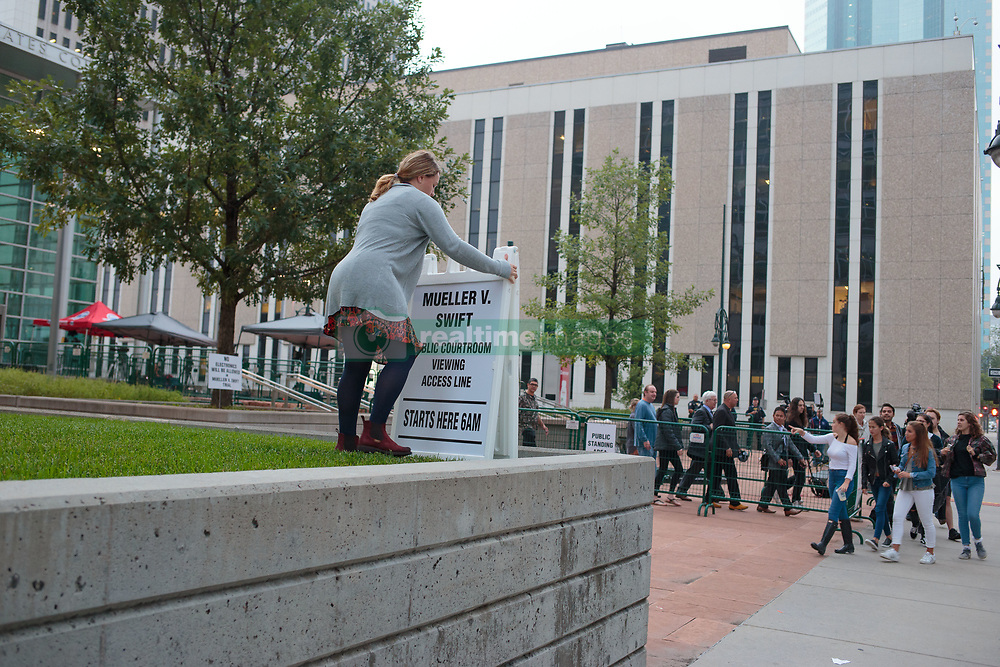 August 8, 2017 - Denver, Colorado, U.S - A court worker places a sign and Swift fans and other people hurry to line up in the proper place at the Taylor Swift Groping Trial against radio DJ David Mueller at the Alfred A. Arraj United States Courthouse in Denver, Colorado, U.S., on Tuesday, August 8, 2017. (Credit Image: © Matthew Staver via ZUMA Wire)