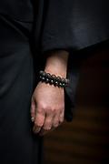 Close-up of human hand wearing prayer beads, Nagano, Japan