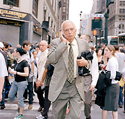New york Business man trying to get home after a steam pipe explosion In Manhatten. The July 18, 2007 New York City steam explosion sent a geyser of hot steam up from beneath a busy intersection, with a 40 story high shower of mud and flying debris raining down on the crowded streets of Midtown Manhattan in New York City. Initial fears that the cause was terrorist related were quickly allayed by statements by mayor Michael Bloomberg and other officials shortly after the event.