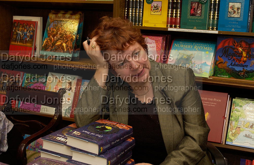 Mary Hoffman, Hatchards christmas party, Piccadilly, 4 December 2003. © Copyright Photograph by Dafydd Jones 66 Stockwell Park Rd. London SW9 0DA Tel 020 7733 0108 www.dafjones.com