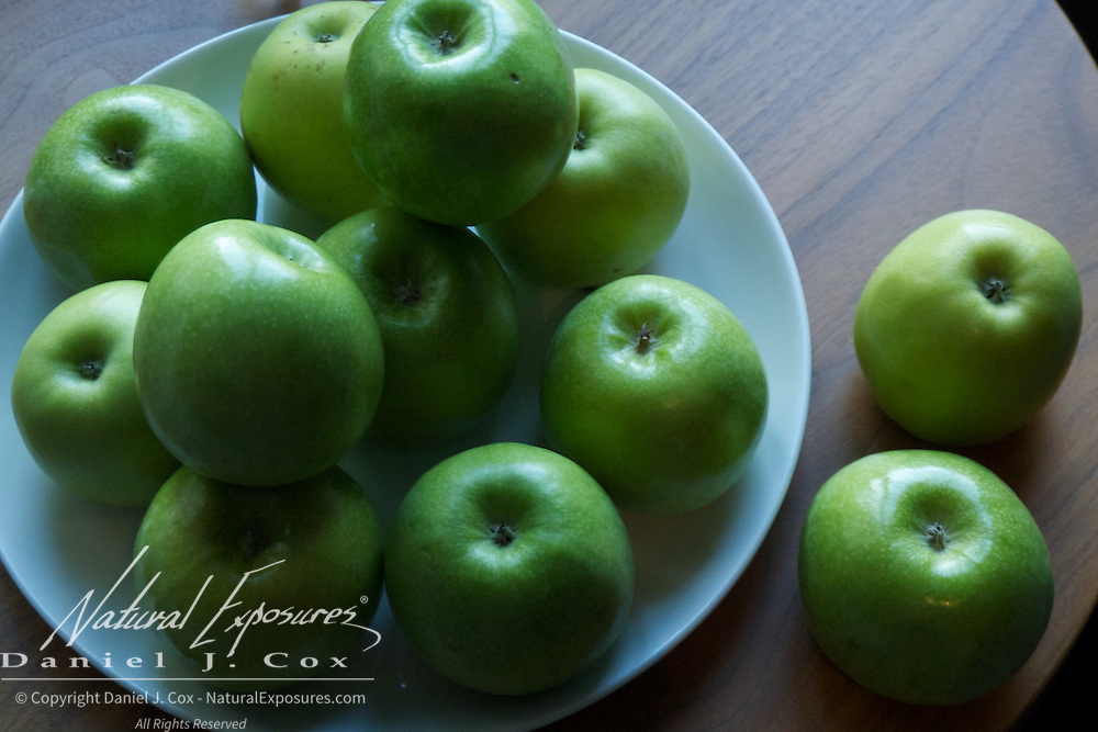 Green apples sit on a table of our hotel, Dublin, Ireland
