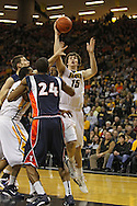 December 29 2010: Iowa Hawkeyes forward Zach McCabe (15) puts up a shot during the first half of an NCAA college basketball game at Carver-Hawkeye Arena in Iowa City, Iowa on December 29, 2010. Illinois defeated Iowa 87-77.