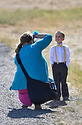 Photographing a young boy dressed up at a wedding.
