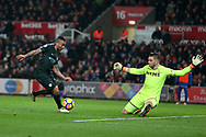 Gabriel Jesus of Manchester City attempts to go past Stoke city goalkeeper Jack Butland.Premier league match, Stoke City v Manchester City at the Bet365 Stadium in Stoke on Trent, Staffs on Monday 12th March 2018.<br /> pic by Andrew Orchard, Andrew Orchard sports photography.