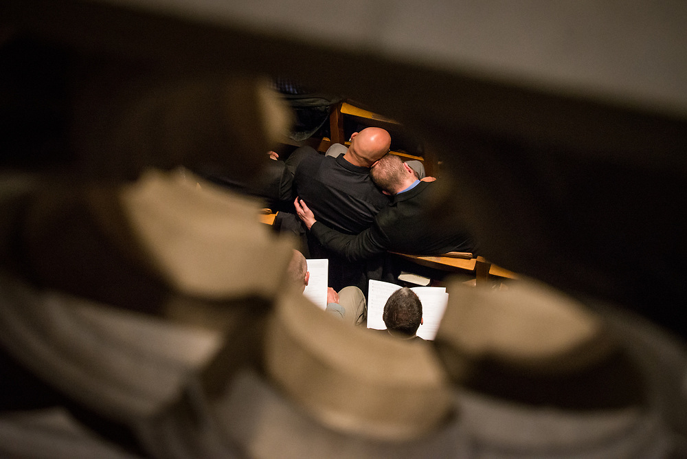 Jesse Jackman and his partner Dirk Caber embrace during a public remembrance service for Matthew Shepard at the Washington National Cathedral in Washington, D.C. on Oct. 26, 2018.<br /> <br /> Credit: Cameron Pollack / NPR