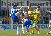 Photo: Ashley Pickering.<br />Colchester United v Norwich City. Coca Cola Championship. 31/03/2007.<br />Kem Izzet of Colchester (L) and Youssef Safri of Norwich challenge for the ball