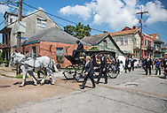 Funeral procession in the Treme. A second line in the Treme on a Sunday Morning,