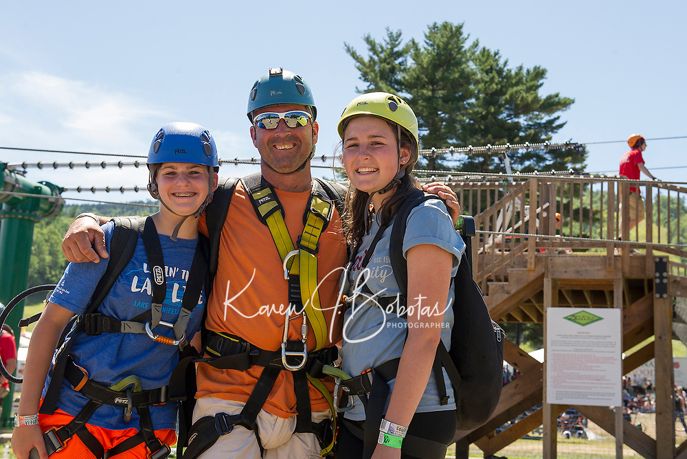 """Sarah, Dave and Nicole Epstein of Bow finish their """"prep"""" zip at the mountain base and prepare to ride the Panorama Lift to the top for their Zipline adventure at Gunstock Mountain Resort.  (Karen Bobotas/for the Laconia Daily Sun)"""