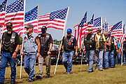 29 AUGUST 2020 - RUNNELLS, IOWA: Members of the Patriot Guard Riders get into formation at the funeral for Pvt. Roy Brown Jr. in Runnells, IA. Pvt. Brown was a US Army soldier in World War II. He was an infantryman in the 126th Infantry Regiment, 32nd Infantry Division, serving in the Australian Territory of Papua (now Papua New Guinea). He went missing in action on Dec. 2, 1942. Unidentified remains were recovered on Feb. 2, 1943 and were eventually interred in the Manila American Cemetery. On May 14, 2019, Defense POW/MIA Accounting Agency using dental records, circumstantial evidence and DNA identified the remains as Pvt. Brown's. He was reinterred in the Lowman Cemetery in Runnells Saturday.     PHOTO BY JACK KURTZ