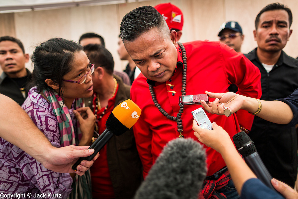 10 MAY 2014 - BANGKOK, THAILAND: JUTAPORN PROMPAN, leader of the Red Shirts, talks to reporters in Bangkok. Thousands of Thai Red Shirts, members of the United Front for Democracy Against Dictatorship (UDD), members of the ruling Pheu Thai party and supporters of the government of ousted Prime Minister Yingluck Shinawatra are rallying on Aksa Road in the Bangkok suburbs. The government was ousted by a court ruling earlier in the week that deposed Yingluck because the judges said she acted unconstitutionally in a personnel matter early in her administration. Thailand now has no functioning government. Red Shirt leaders said at the rally Saturday that any attempt to impose an unelected government on Thailand could spark a civil war. This is the third consecutive popularly elected UDD supported government ousted by the courts in less than 10 years.    PHOTO BY JACK KURTZ