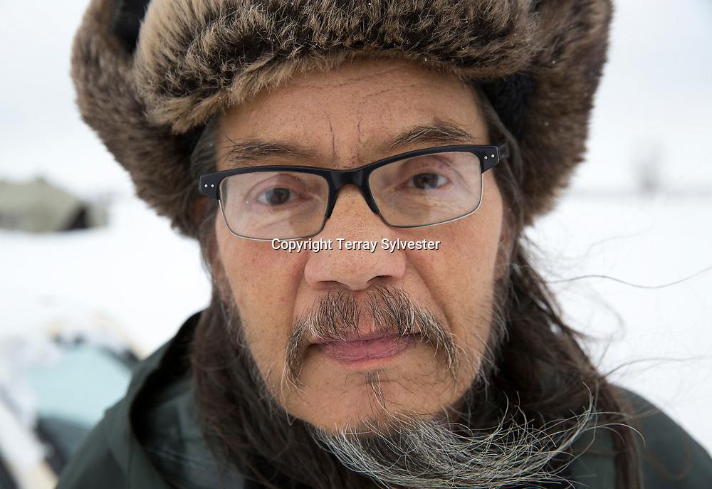 Steve Voliva, of the Yupik people in Alaska, poses for a portrait in the opposition camp against the Dakota Access oil pipeline on November 30, 2016. Cannon Ball, North Dakota, United States.