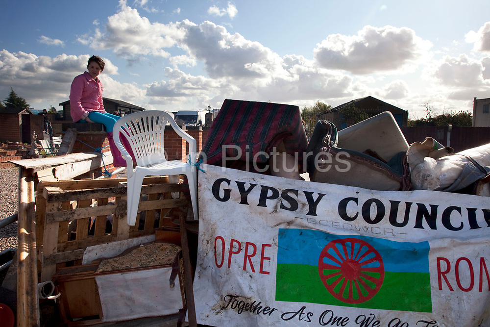 Traveller children play on the site even though they would leave their homes so soon. Protesters who barricaded themselves above the entrance to the Dale Farm travellers' site have been removed by police as bailiffs prepare to move in. Essex Police cleared the scaffolding structure so it could be dismantled and machinery driven in by bailiffs to evict the travellers. On Wednesday night Essex Police said that over the course of the day 23 people had been arrested. Clearance of Dale Farm prior to eviction. Riot police and bailiffs were present on 19th October 2011, as a scaffolding gantry was cleared of protesters so the site could be cleared. Dale Farm is part of a Romany Gypsy and Irish Traveller site on Oak Lane in Crays Hill, Essex, United Kingdom. Dale Farm housed over 1,000 people, the largest Traveller concentration in the UK. The whole of the site is owned by residents and is located within the Green Belt. It is in two parts: in one, residents constructed buildings with planning permission to do so; in the other, residents were refused planning permission due to the green belt policy, and built on the site anyway.