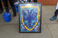 AFC Wimbledon crest artworj during the EFL Sky Bet League 1 match between AFC Wimbledon and Accrington Stanley at the Cherry Red Records Stadium, Kingston, England on 6 April 2019.
