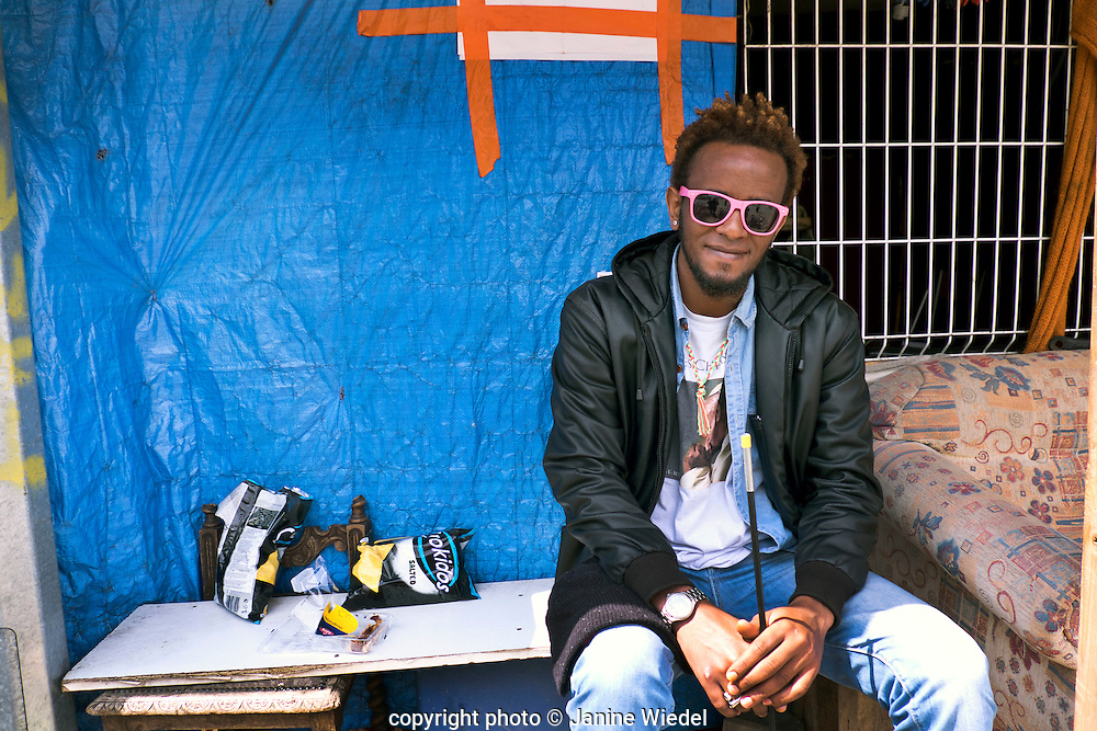 Ethiopian refugee in the  Calais Jungle Refugee and Migrant Camp in France