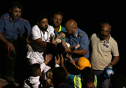 Aug. 22, 2017 - Ischia, Italy - Rescue workers save a baby after an earthquake hit the island. Emergency teams raced against time on Tuesday to rescue victims of a 4.0-magnitude earthquake that hit the Italian southern island of Ischia on Monday evening. The temblor killed at least two women, and wounded 39 people, according to latest reports. (Credit Image: © Xinhua via ZUMA Wire)
