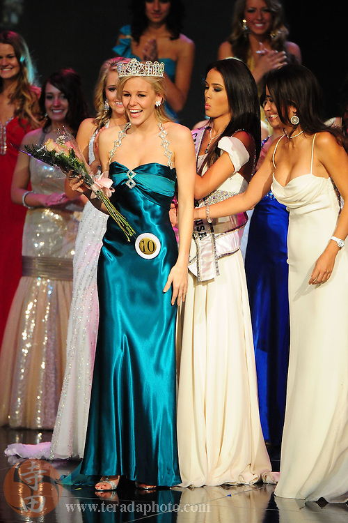 """November 22, 2009; Rancho Mirage, CA, USA; Miss Poway Teen USA Emma Baker (10) reacts after winning as Miss California Teen USA 2009 Chelsea Gilligan (second from right) applies the crown and sash during the Miss California Teen USA 2010 Pageant at """"The Show"""" at the Agua Caliente Resort & Spa. Mandatory Credit: Kyle Terada-Terada Photo"""
