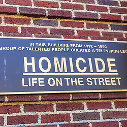 Baltimore, MD, USA - July 26, 2011: A sign on the Recreation Pier at Fells Point in Baltimore commemorates the building had been featured as police headquarters on  Homicide: Life on the Street.