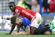 Eric Bailly of Manchester United elbows Gary Cahill of Chelsea. Premier league match, Chelsea v Manchester Utd at Stamford Bridge in London on Sunday 23rd October 2016.<br /> pic by John Patrick Fletcher, Andrew Orchard sports photography.