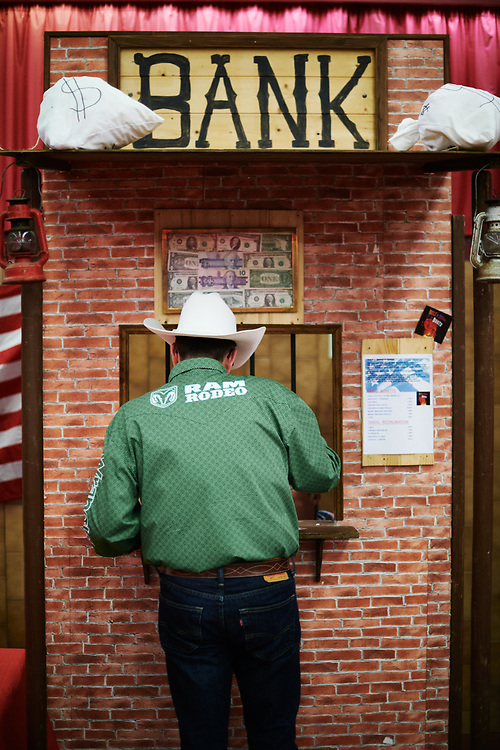 Un homme a la caisse, durant une soiree de danse et concert country organisee par l'association Hell's Boots. Villeneuve-Saint-Germain, France. 17 novembre 2019. <br /> A man attending the cashier box at a Country Dance & concert night, held by the Hell's Boots association. Villeneuve-Saint-Germain, France. November 17, 2019.