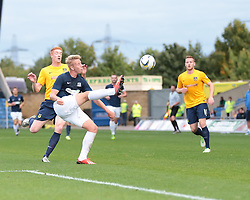 Southend United's Adam Thompson clears from Oxford United's Dave Kitson - Photo mandatory by-line: Nigel Pitts-Drake/JMP - Tel: Mobile: 07966 386802 05/10/2013 - SPORT - FOOTBALL - Kassam Stadium - Oxford - Oxford United v Southend United - Sky Bet League 2