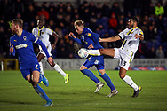 AFC Wimbledon midfielder Mitchell (Mitch) Pinnock (11) battles for possession with Burton Albion defender Colin Daniel (3) during the EFL Sky Bet League 1 match between AFC Wimbledon and Burton Albion at the Cherry Red Records Stadium, Kingston, England on 28 January 2020.