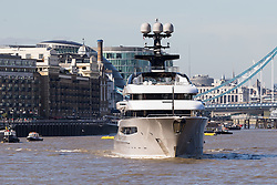 October 3, 2016 - London, London, UK - LONDON, UK.  Superyacht, Kismet leaves London on the River Thames passing in front of Tower Bridge during blue skies and sunny autumn weather this lunchtime, after mooring at Butlers Wharf last week. Kismet is 308 feet long and is reportedly owned by Pakistani-American billionaire Shahid Khan, who owns the National Football League (NFL) team, the Jacksonville Jaguars, who played the Colts in an International Series game at Wembley yesterday. Kismet has 6 staterooms, with the master bedroom having its own private deck with jacuzzi and helipad and can be chartered for an estimated £1m per week. (Credit Image: © Vickie Flores/London News Pictures via ZUMA Wire)