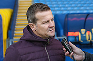 Forest Green Rovers manager, Mark Cooper being interviewed before the match  during the The FA Cup 1st round match between Oxford United and Forest Green Rovers at the Kassam Stadium, Oxford, England on 10 November 2018.