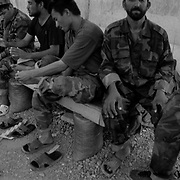 Jun 12, 2009 - Kandahar Province, Afghanistan - Afghan troops socialize over tea before evening prayer in their forward operating base after a day of fighting in the village of Howz E Madad west of Kandahar City, Afghanistan..(Credit Image: © Louie Palu/ZUMA Press)