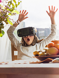 Girl scared during virtual reality exploration