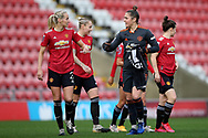 Manchester United defender Millie Turner (21) and Manchester United goalkeeper Mary Earps (27) during the FA Women's Super League match between Manchester United Women and Manchester City Women at Leigh Sports Village, Leigh, United Kingdom on 14 November 2020.