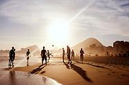 A group of guys play altinho at Copacabana Beach. Altinho is a popular beach football game in Brazil.