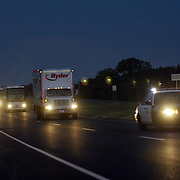 Oregon Ducks football team in Oklahoma for game against against the Sooners..Oklahoma State Troopers escort the equipment truck (Ryder) and several team buses to the airport following the loss to OU..Photos © Todd Bigelow/Aurora