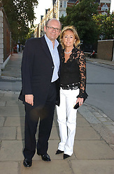 City millionaire MICHAEL SPENCER and his wife LORRAINE at the Concervative Party Summer Party held in the gardnes of The Royal Hospital, Chelsea, London on 3rd July 2006.<br /><br />NON EXCLUSIVE - WORLD RIGHTS