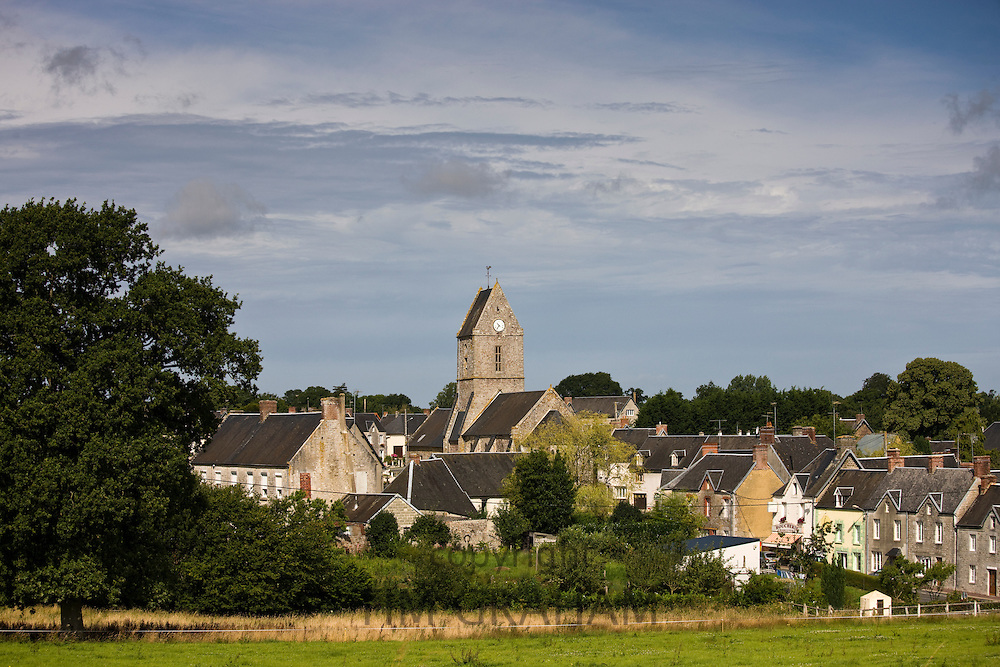 Church and housing in French town of Trelly in Normandy, France