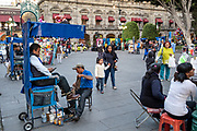 Families enjoy an evening out in the central City Square called the Zocalo de Puebla in Puebla, Mexico.