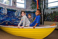 London, Adam and David use their imagination as they sail off to help another boat in distress following Laconia Library's preschool story hour Wednesday morning.  (Karen Bobotas/for the Laconia Daily Sun)