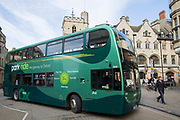 Green park and ride bus in Oxford City, England, United Kingdom. This bus scheme encourages people to park their cars outside the city centre to reduce congestion.