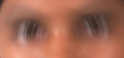Blurred close up of child's eyes and nose,